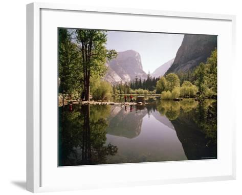 Children on Rocks on Mirror Lake in Yosemite National Park with Mountain Rising in the Background-Ralph Crane-Framed Art Print