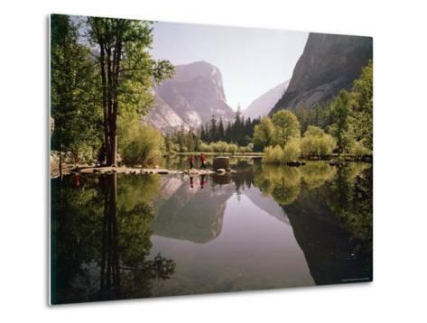 Children on Rocks on Mirror Lake in Yosemite National Park with Mountain Rising in the Background-Ralph Crane-Metal Print