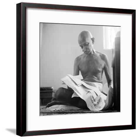 Indian Leader Mohandas Gandhi Reading as He Sits Cross Legged on Floor, at Home-Margaret Bourke-White-Framed Art Print
