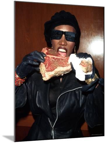 Singer Grace Jones Putting Raw Steak to Mouth-Marion Curtis-Mounted Premium Photographic Print