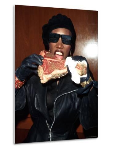Singer Grace Jones Putting Raw Steak to Mouth-Marion Curtis-Metal Print