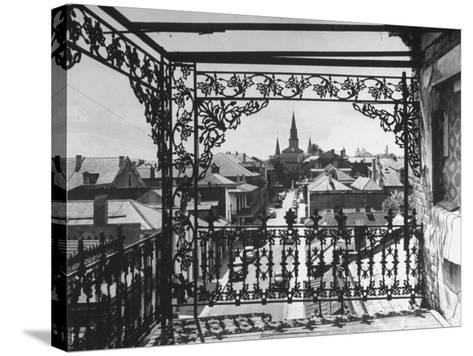 Orleans Street, Center of Old French Quarter of City, Through Grillwork of a Balcony-Andreas Feininger-Stretched Canvas Print