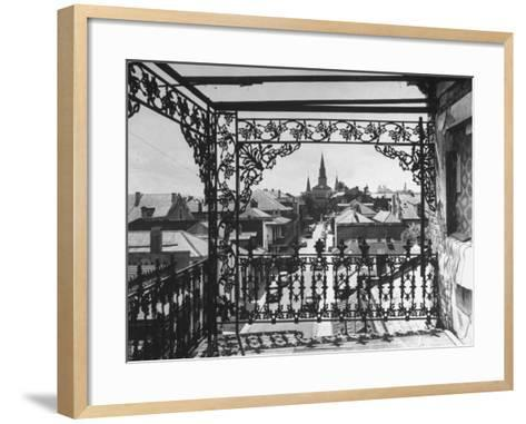 Orleans Street, Center of Old French Quarter of City, Through Grillwork of a Balcony-Andreas Feininger-Framed Art Print