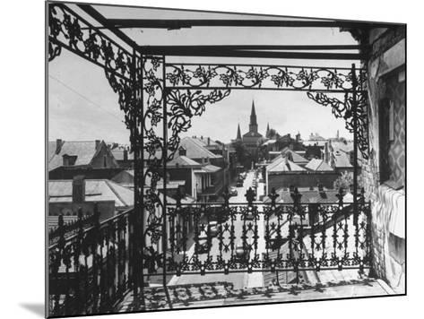 Orleans Street, Center of Old French Quarter of City, Through Grillwork of a Balcony-Andreas Feininger-Mounted Photographic Print