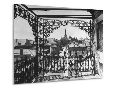 Orleans Street, Center of Old French Quarter of City, Through Grillwork of a Balcony-Andreas Feininger-Metal Print