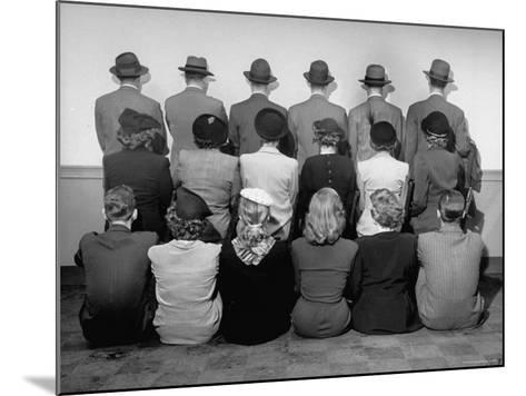Macy's Department Store Detectives with Their Backs Turned So as Not to Reveal Their Identity-Nina Leen-Mounted Photographic Print