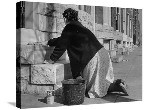 Housewife Washing Her White Stoop During Part of Her Daily Routine-Margaret Bourke-White-Stretched Canvas Print