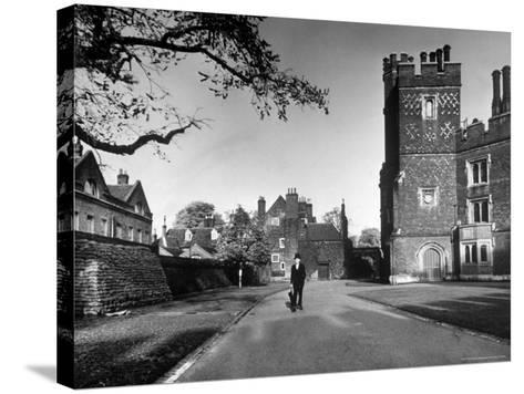 Eton Student in Traditional Tails and Topper Walking in Front of Weston Yard-Margaret Bourke-White-Stretched Canvas Print
