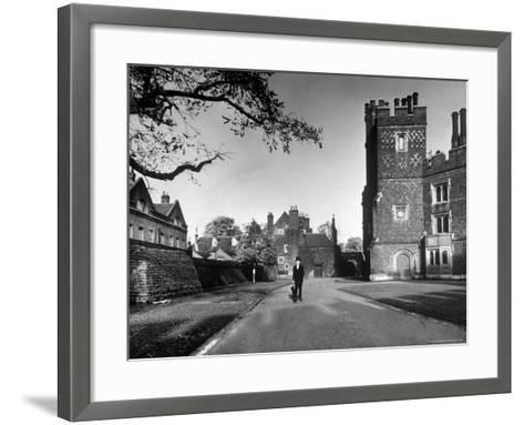 Eton Student in Traditional Tails and Topper Walking in Front of Weston Yard-Margaret Bourke-White-Framed Art Print