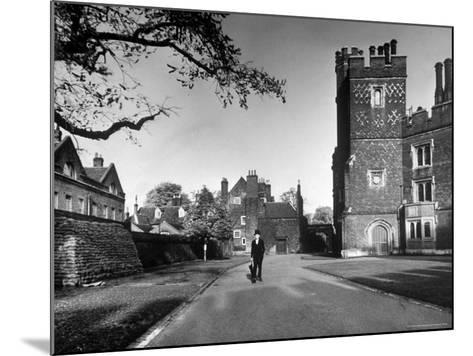 Eton Student in Traditional Tails and Topper Walking in Front of Weston Yard-Margaret Bourke-White-Mounted Photographic Print