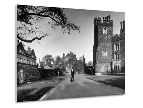 Eton Student in Traditional Tails and Topper Walking in Front of Weston Yard-Margaret Bourke-White-Metal Print