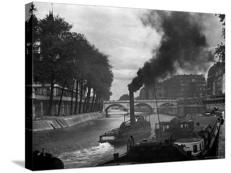 River Boat Smoke Passes along the River Seine-Andreas Feininger-Stretched Canvas Print