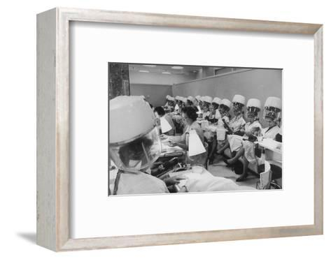 Women under Hair Dryers Getting Hair Styled in Beauty Salon at Saks Fifth Ave. Department Store-Alfred Eisenstaedt-Framed Art Print