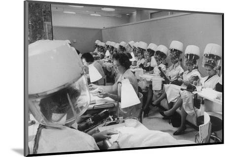 Women under Hair Dryers Getting Hair Styled in Beauty Salon at Saks Fifth Ave. Department Store-Alfred Eisenstaedt-Mounted Photographic Print
