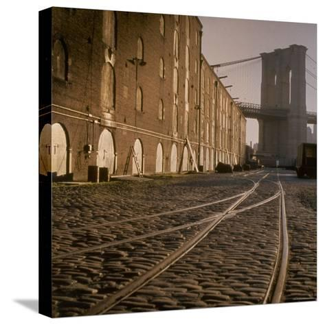 Shuttered Warehouses Lit by Sunlight on Trolley Track Railed Street Along Brooklyn Waterfront-Walker Evans-Stretched Canvas Print