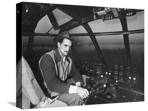 "Howard Hughes Sitting at the Controls of His 200 Ton Flying Boat Called the ""Spruce Goose""-J^ R^ Eyerman-Stretched Canvas Print"