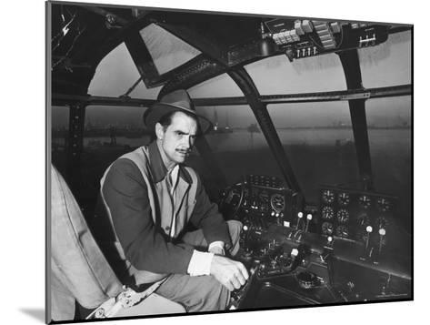 "Howard Hughes Sitting at the Controls of His 200 Ton Flying Boat Called the ""Spruce Goose""-J^ R^ Eyerman-Mounted Premium Photographic Print"
