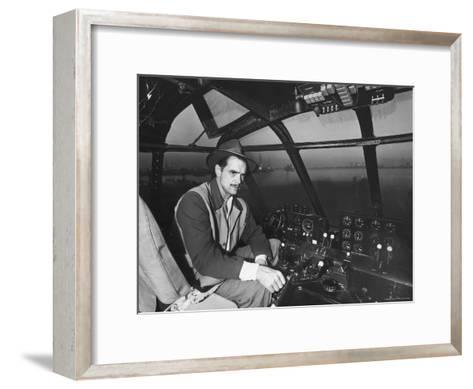 "Howard Hughes Sitting at the Controls of His 200 Ton Flying Boat Called the ""Spruce Goose""-J^ R^ Eyerman-Framed Art Print"