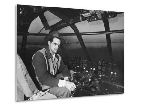 "Howard Hughes Sitting at the Controls of His 200 Ton Flying Boat Called the ""Spruce Goose""-J^ R^ Eyerman-Metal Print"