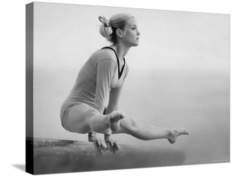 Gymnast Cathy Rigby, Training on Balancing Beam-John Dominis-Stretched Canvas Print