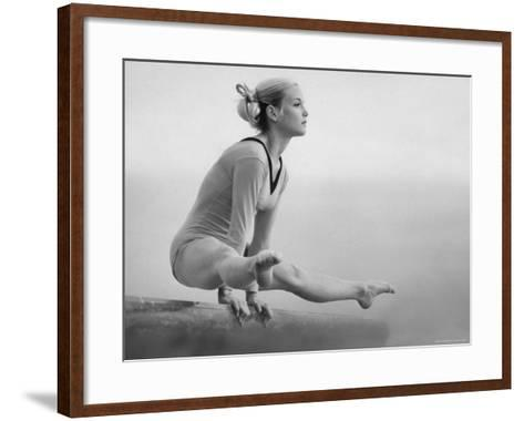 Gymnast Cathy Rigby, Training on Balancing Beam-John Dominis-Framed Art Print