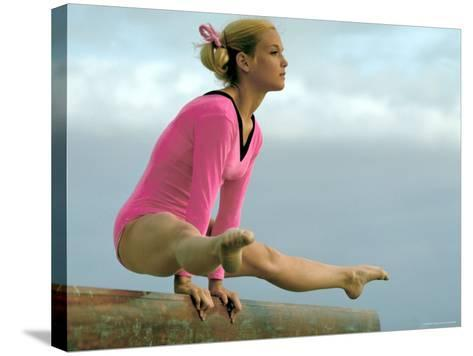 Teen Gymnast Cathy Rigby Performing on Balance Beam-John Dominis-Stretched Canvas Print