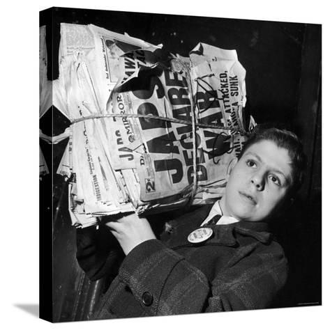 Boy from the Madison Square Boys' Club Carrying a Bundle of Newspapers After Attack on Pearl Harbor-Dmitri Kessel-Stretched Canvas Print