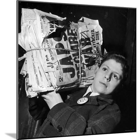 Boy from the Madison Square Boys' Club Carrying a Bundle of Newspapers After Attack on Pearl Harbor-Dmitri Kessel-Mounted Photographic Print