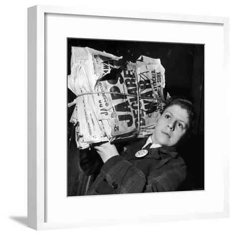 Boy from the Madison Square Boys' Club Carrying a Bundle of Newspapers After Attack on Pearl Harbor-Dmitri Kessel-Framed Art Print
