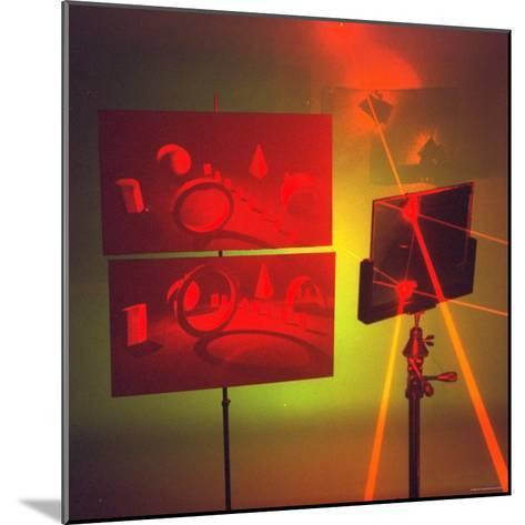 Hologram made by Juris Upatnieks projects on screens when lasers passes through different places-Fritz Goro-Mounted Photographic Print