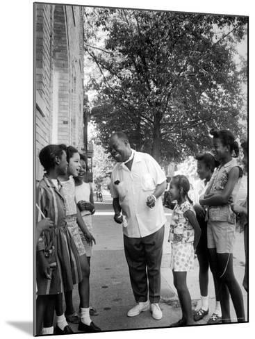 Musician Louis Armstrong with Neighborhood Kids-John Loengard-Mounted Premium Photographic Print