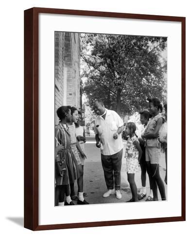 Musician Louis Armstrong with Neighborhood Kids-John Loengard-Framed Art Print