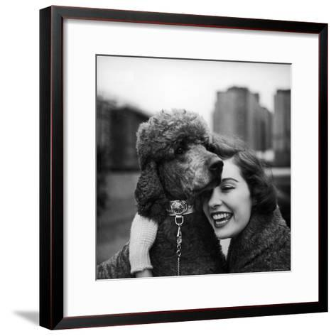 Woman Profiling a Big Smile While Adoring Her Poodle Wearing Large Swiss Watch on Dog Collar-Yale Joel-Framed Art Print