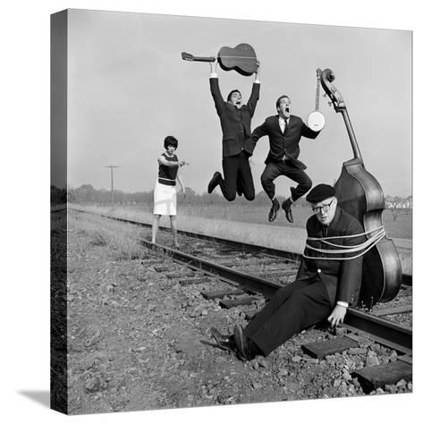 """The Whiskey Hill Singers, Singing One of Their Songs, """"Railroad Bill""""-Ralph Crane-Stretched Canvas Print"""