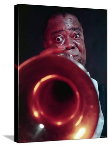 Jazz Musician Louis Armstrong Blowing on Trumpet-Eliot Elisofon-Stretched Canvas Print