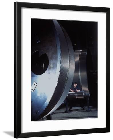 Man Dwarfed by Gigantic Gears He is Working on for the Navy, at General Electric Plant in US-Dmitri Kessel-Framed Art Print