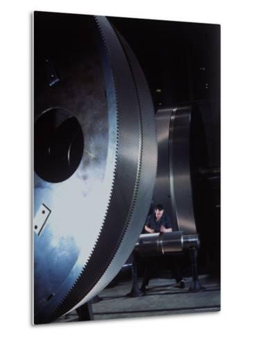 Man Dwarfed by Gigantic Gears He is Working on for the Navy, at General Electric Plant in US-Dmitri Kessel-Metal Print