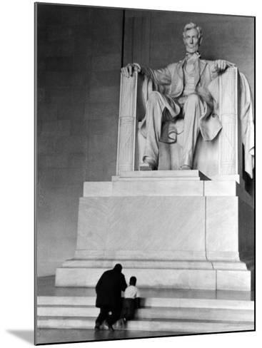 Black Man and Small Boy Kneeling Prayerfully on Steps on Front of Statue in the Lincoln Memorial-Thomas D^ Mcavoy-Mounted Photographic Print
