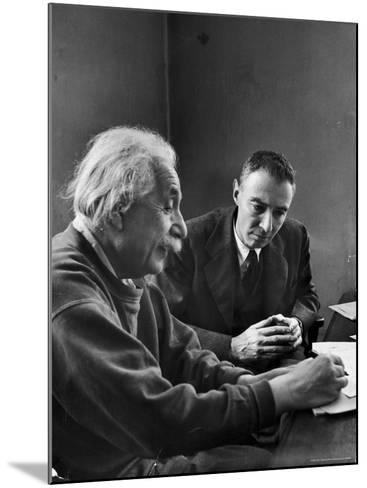 Physicist J. Robert Oppenheimer Discusses Theory of Matter with Famed Physicist Dr. Albert Einstein-Alfred Eisenstaedt-Mounted Premium Photographic Print
