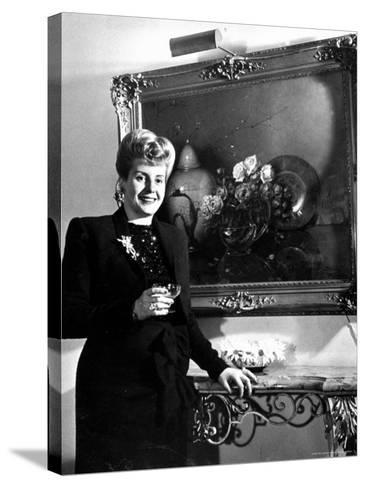 Evita Peron, Wife of Argentinean Presidential Candidate With. a Glass of Champagne in Her Apartment-Thomas D^ Mcavoy-Stretched Canvas Print