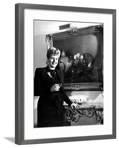 Evita Peron, Wife of Argentinean Presidential Candidate With. a Glass of Champagne in Her Apartment-Thomas D^ Mcavoy-Framed Art Print