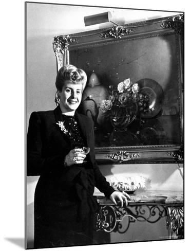 Evita Peron, Wife of Argentinean Presidential Candidate With. a Glass of Champagne in Her Apartment-Thomas D^ Mcavoy-Mounted Premium Photographic Print