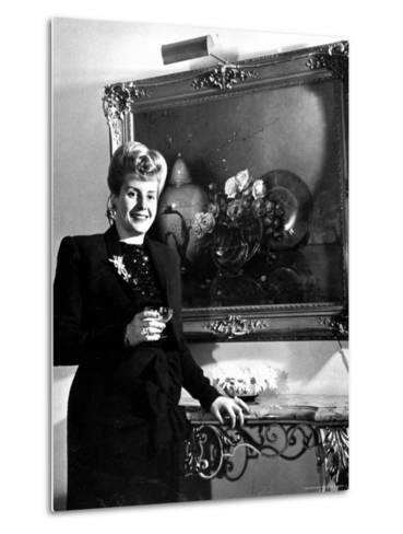 Evita Peron, Wife of Argentinean Presidential Candidate With. a Glass of Champagne in Her Apartment-Thomas D^ Mcavoy-Metal Print