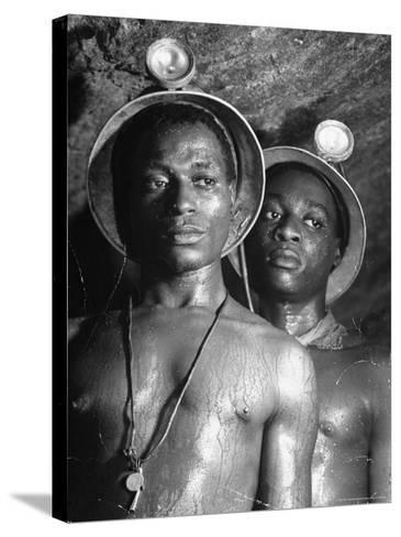 Gold Miners, Wearing Helmets and Perspiring Heavily, Standing in Robinson Deep Diamond Mine Tunnel-Margaret Bourke-White-Stretched Canvas Print