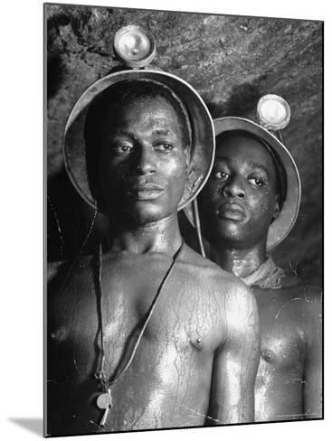 Gold Miners, Wearing Helmets and Perspiring Heavily, Standing in Robinson Deep Diamond Mine Tunnel-Margaret Bourke-White-Mounted Photographic Print