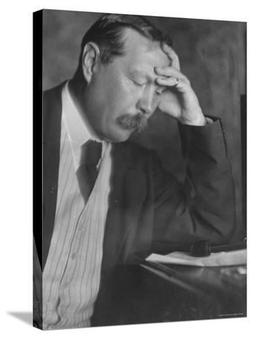 Photo by E. O. Hoppe of Author Sir Arthur Conan Doyle Seated, Eyes Downcast, in Reflective Pose-Emil Otto Hopp?-Stretched Canvas Print