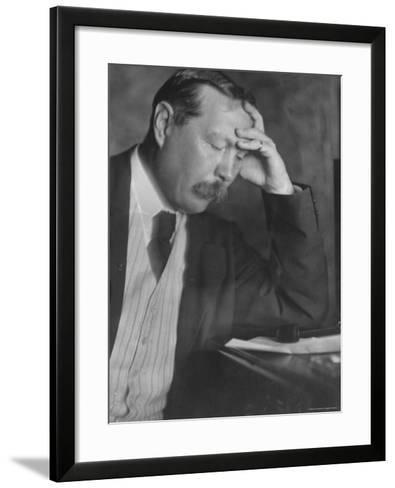 Photo by E. O. Hoppe of Author Sir Arthur Conan Doyle Seated, Eyes Downcast, in Reflective Pose-Emil Otto Hopp?-Framed Art Print
