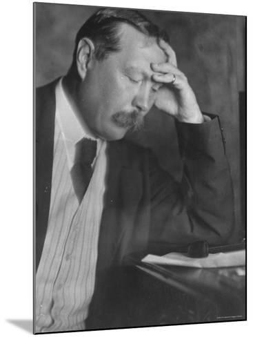 Photo by E. O. Hoppe of Author Sir Arthur Conan Doyle Seated, Eyes Downcast, in Reflective Pose-Emil Otto Hopp?-Mounted Premium Photographic Print