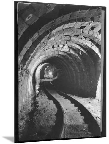 Electric Locomotive on Track in Powderly Anthracite Coal Mine Gangway, Owned by Hudson Coal Co-Margaret Bourke-White-Mounted Photographic Print