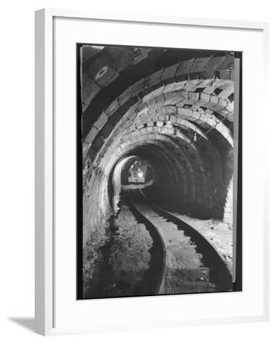 Electric Locomotive on Track in Powderly Anthracite Coal Mine Gangway, Owned by Hudson Coal Co-Margaret Bourke-White-Framed Art Print